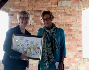 Wendy Cooling presents the award to Elaine McQuade from OUP: a framed picture of Ros Asquith's 'little rebels'